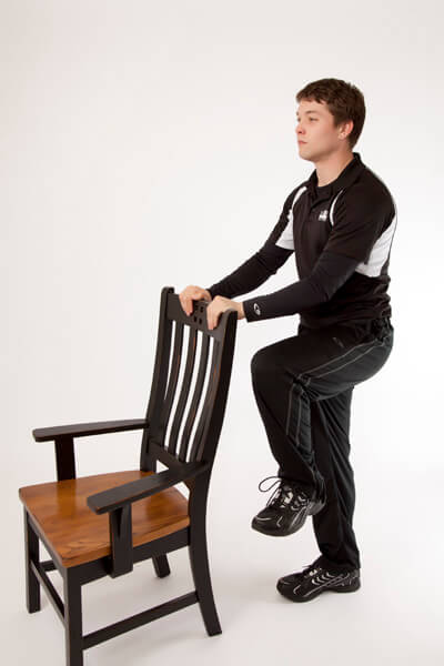 Standing Knee Raise Holding Chair Live 2 B Healthy Trainers